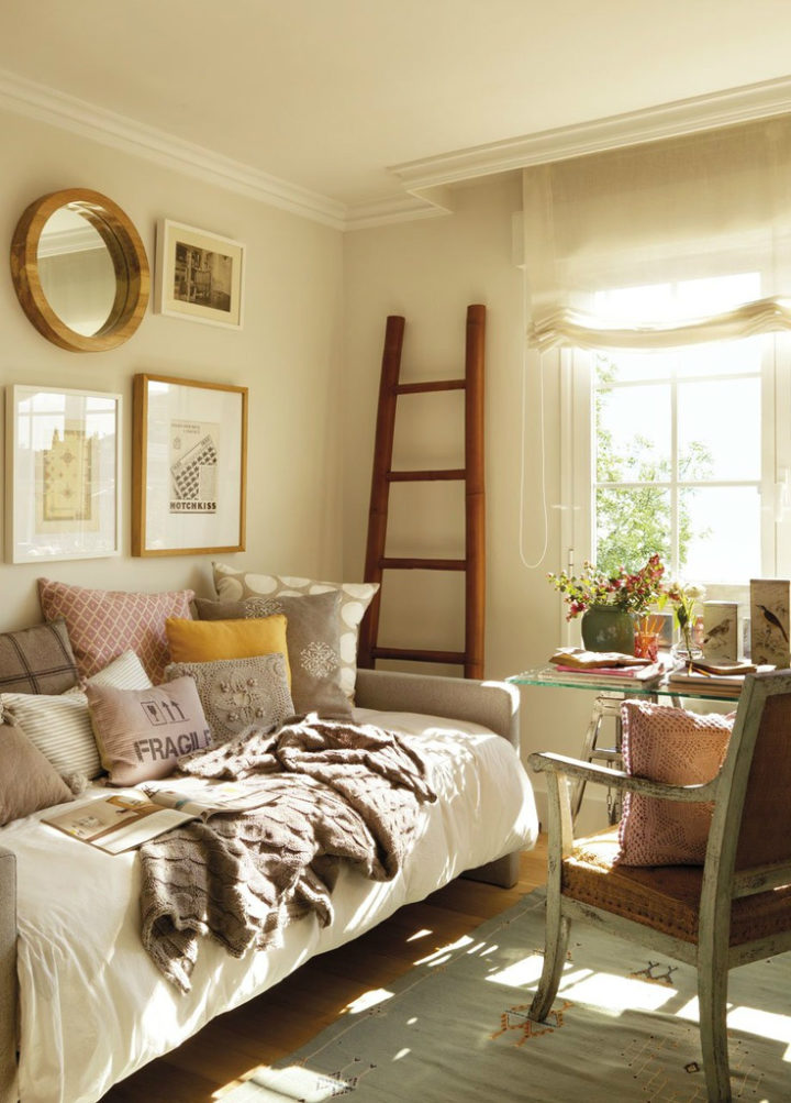 beige room with frames on the wall