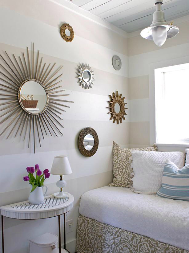 guest bedroom with round mirrors