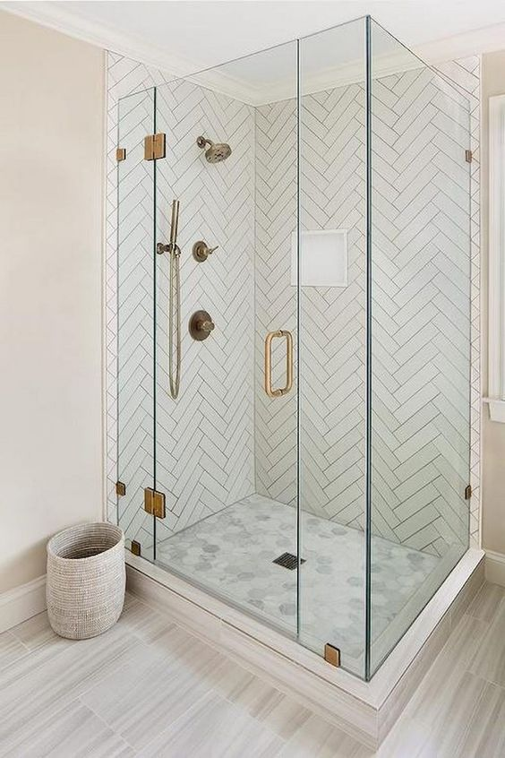 glass walk in shower with gold accents