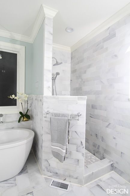 white marble built walk in shower without door