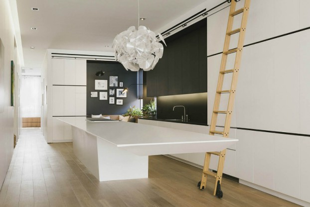 minmal black white kitchen with ladder and large lighting