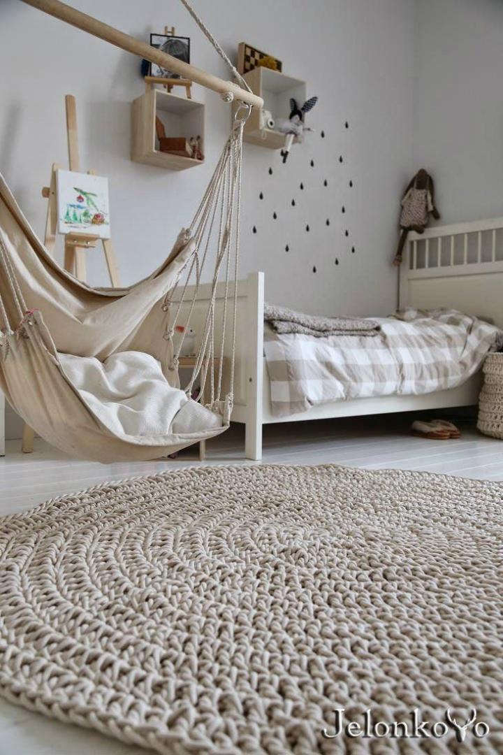 beige hammock in a bedroom