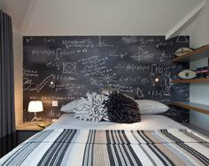 bedroom with a chalkboard above bed