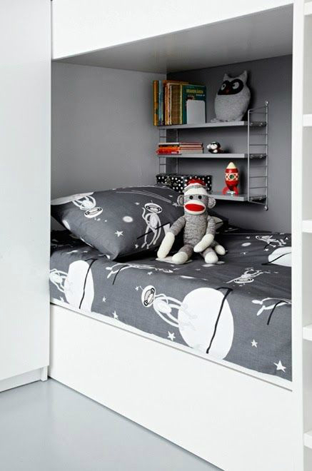 child's bed with toys nearby