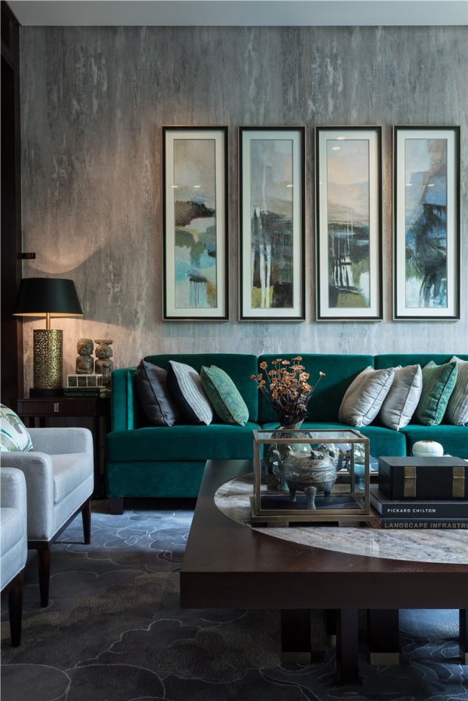 gray living room with emerald bue green velvet sofa