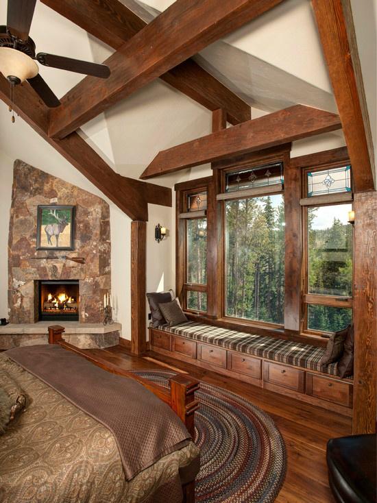 brown fireplace in bedroom