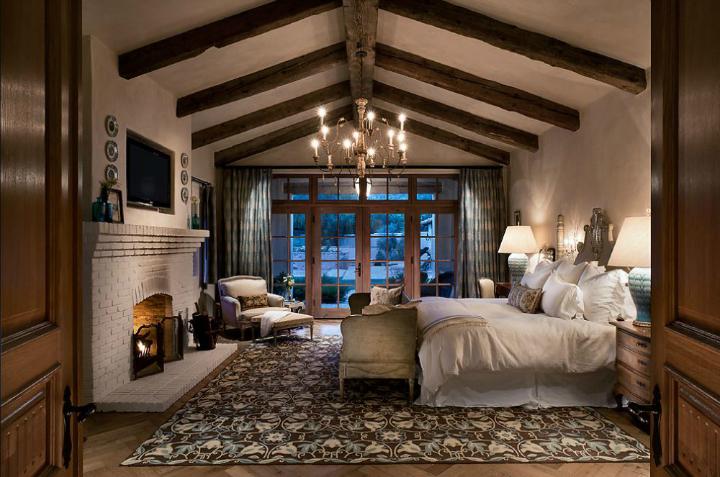 exposed beams in fireplace in bedroom