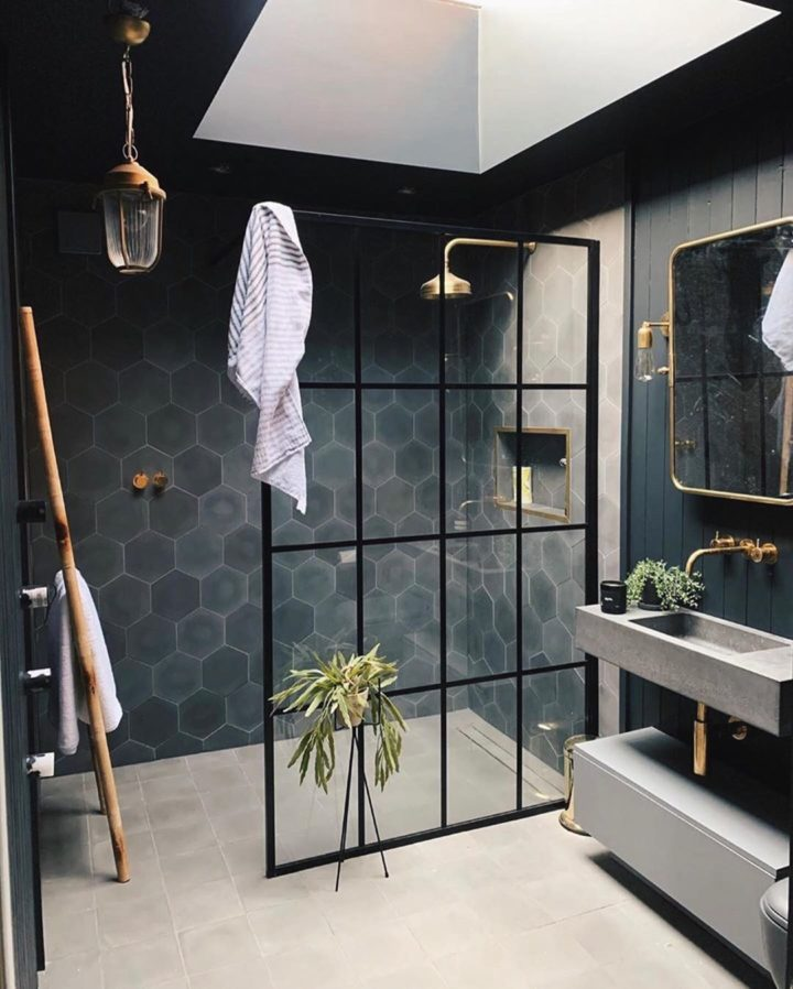 walk in shower with black hexagon tiles gold fixture and glass black aluminium hunting enclosure