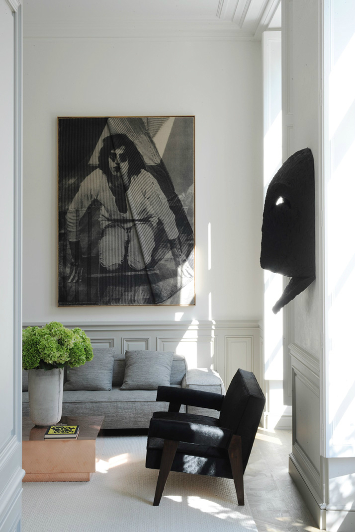 black armchair and a painting