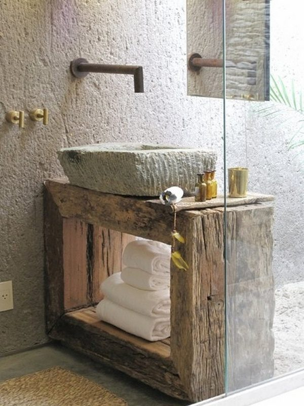 Wabi Sabi bathroom with stone sink, rough wood vanity, and industrial hardware