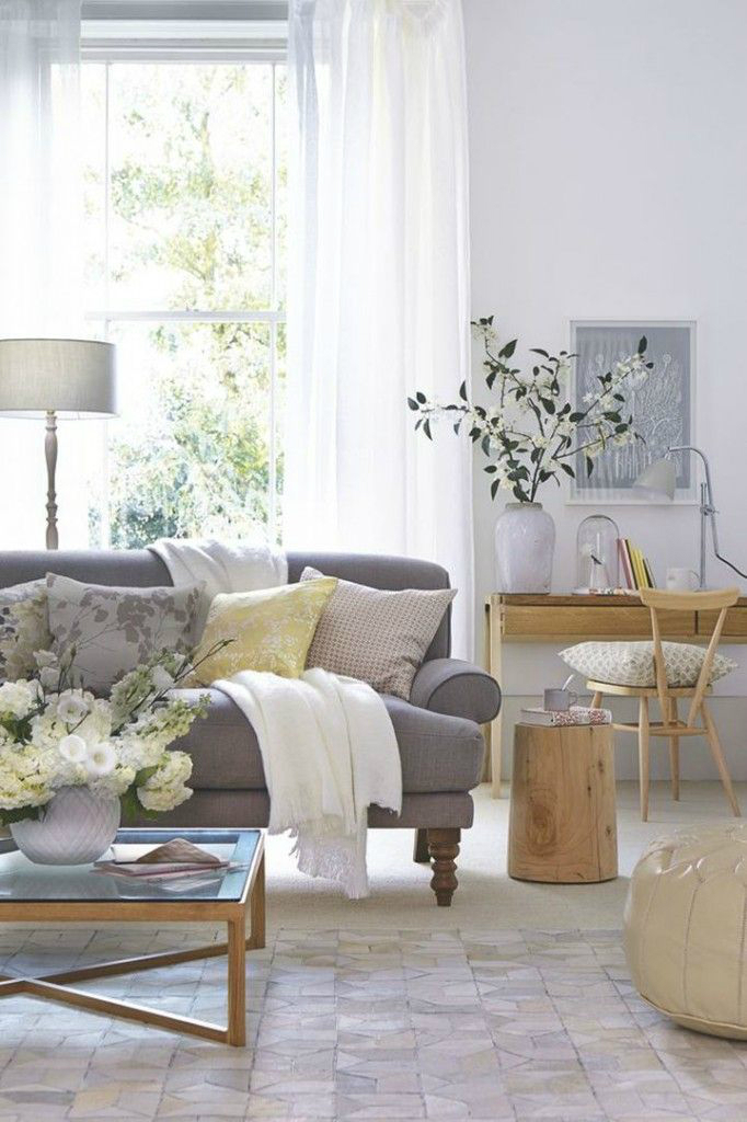 dark colored gray sofa with light neutral pillows