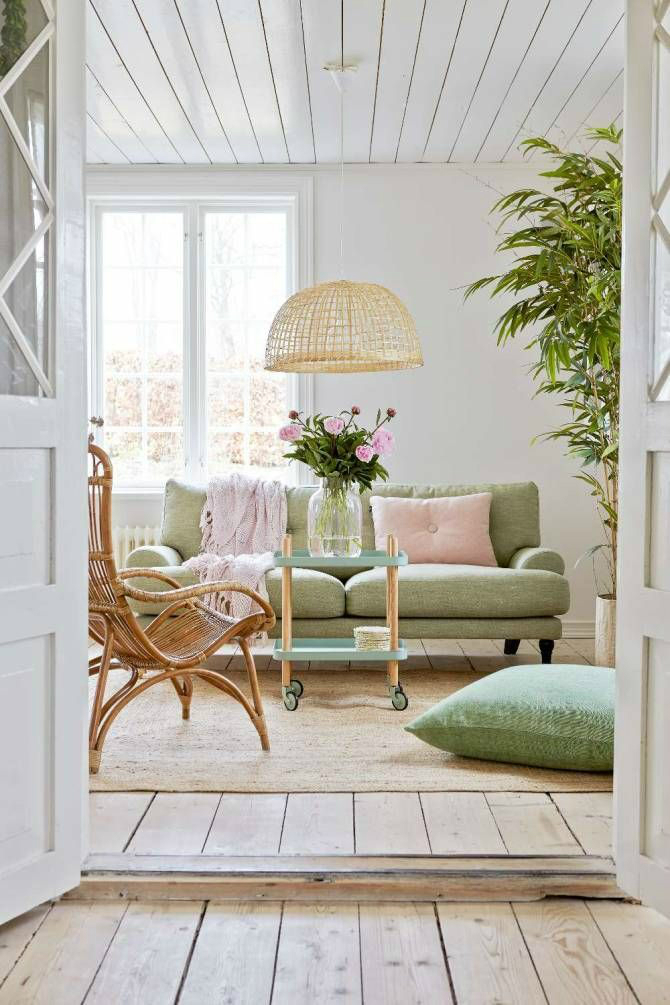 living room with white walls and light green pistachio sofa
