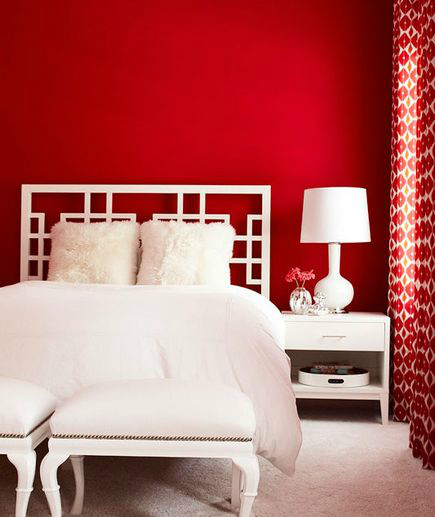 red wall and white bed bedroom