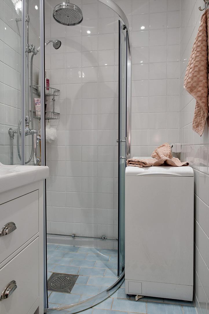 tiny bathroom with washing machine