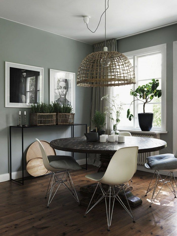 dining room with old and new furniture mixing ad gray wall