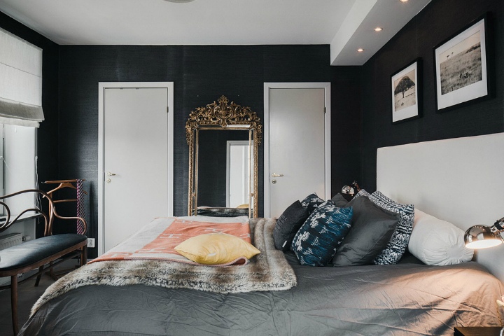 double bed and a mirror in bedroom