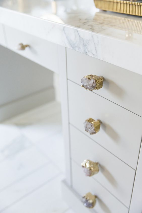 Cabinet knobs are the Crowned Quartz Knob by Anthropologie