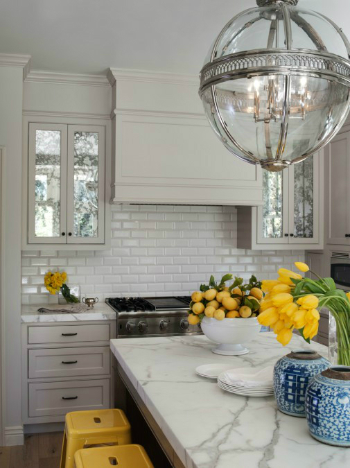 gray kitchen with yellow tulips and lemons decorations