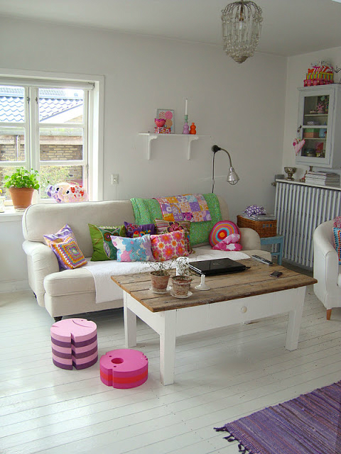 Bright color pillows combination on white sofa