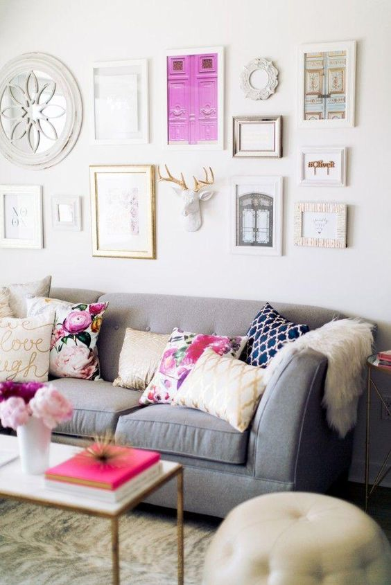 contemporary living room with gray sofa and pink touches