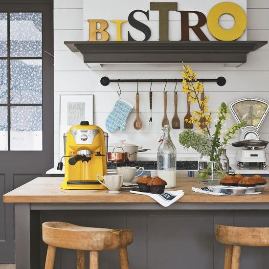 While the wooden stools and countertop are classic country, the bright yellow accessories and large letters on the shelf give this kitchen a new twist