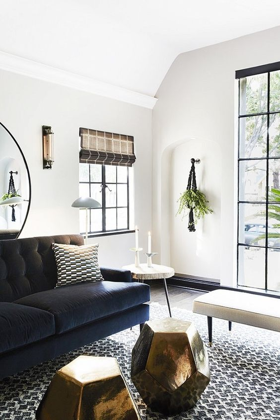 transitional living room with deep blue velvet sofa