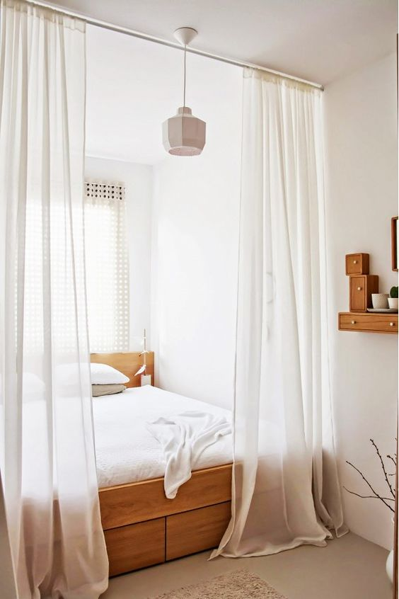 window shades that are closer to the ceiling will make your bedroom feel and appear taller