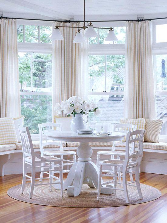 elegant breakfast nook with bay windows