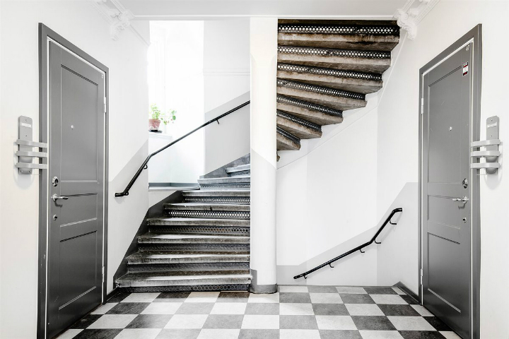 old Scandinavian staircase and black and white tiles