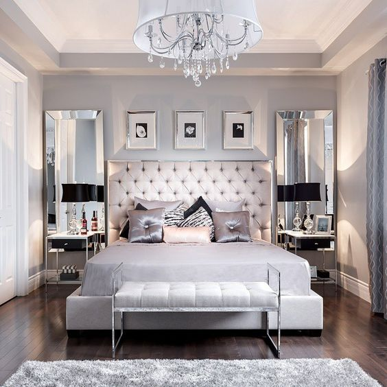 white chandelier in a bedroom with a double bed and pink details