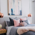 gray and pink bedroom with copper lights