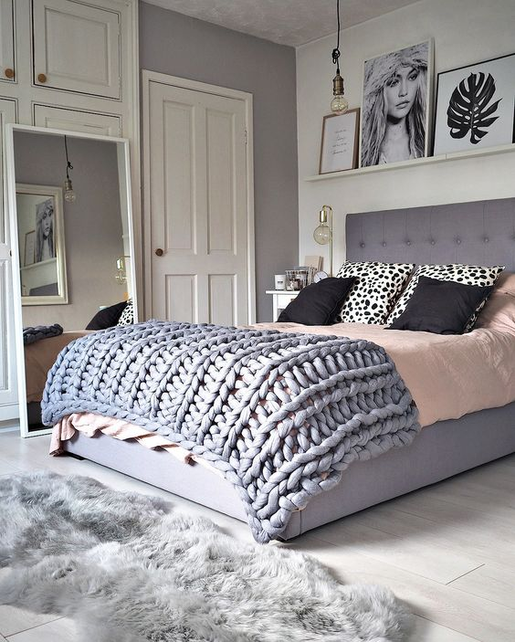 double bed with gray, black, pink and white details