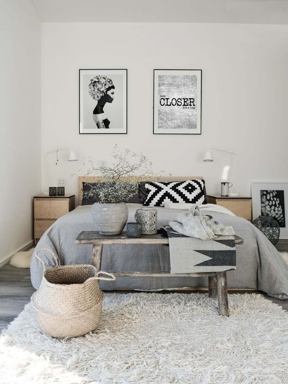 light grey room with rugs and frames