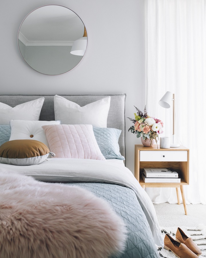 grey bedroom with pastel colors