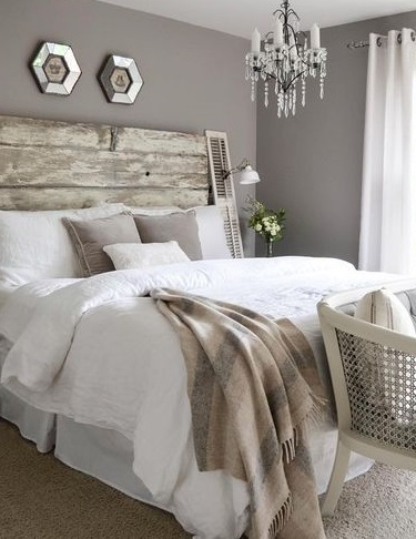 white bed sheets and gray decor details