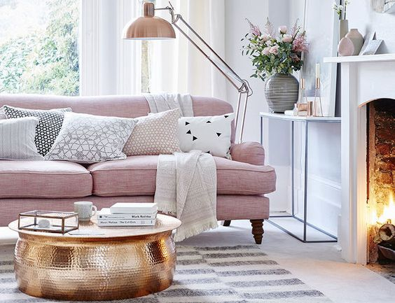 living room with pink sofa