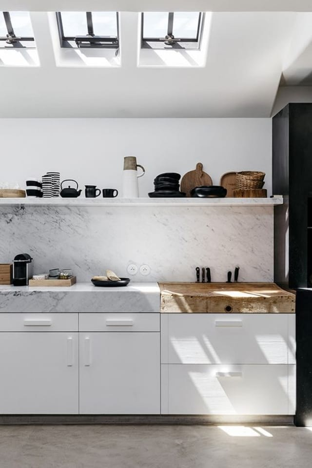 white minimalist kitchen with open shelves