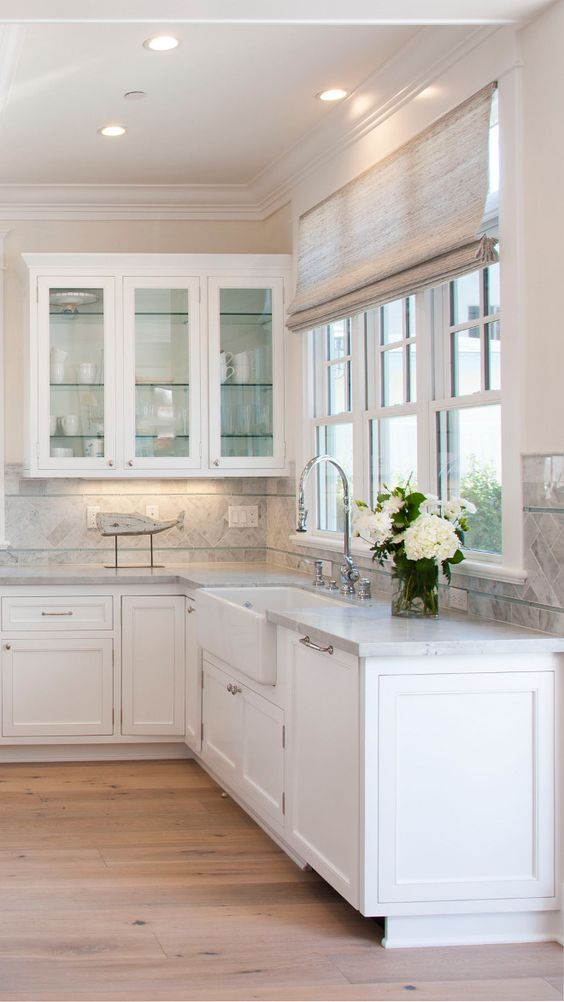 glass cabinets near a sink