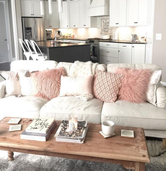 living room with blush pink pillows