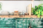 green kitchen tiles with wood shelves