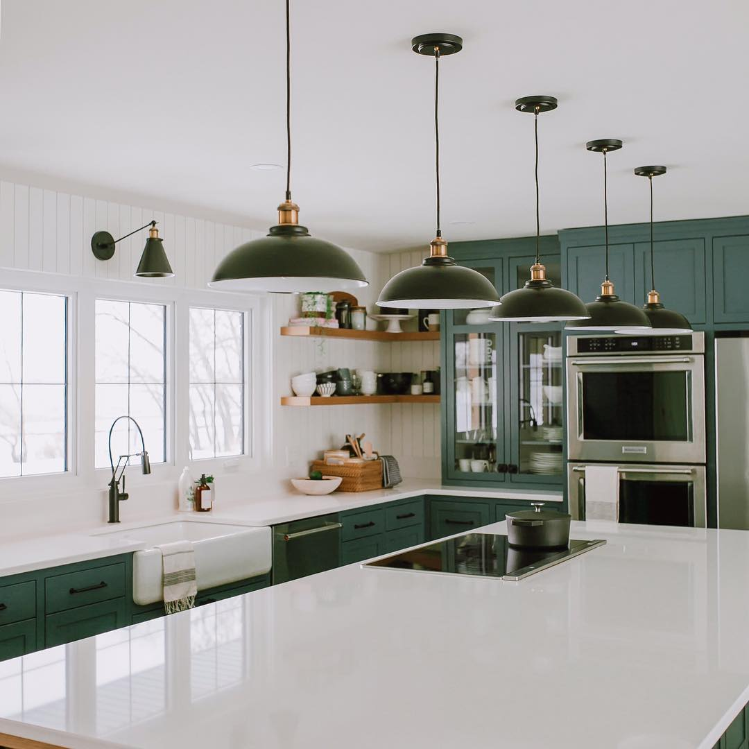 best green kitchen with oversized quartz island
