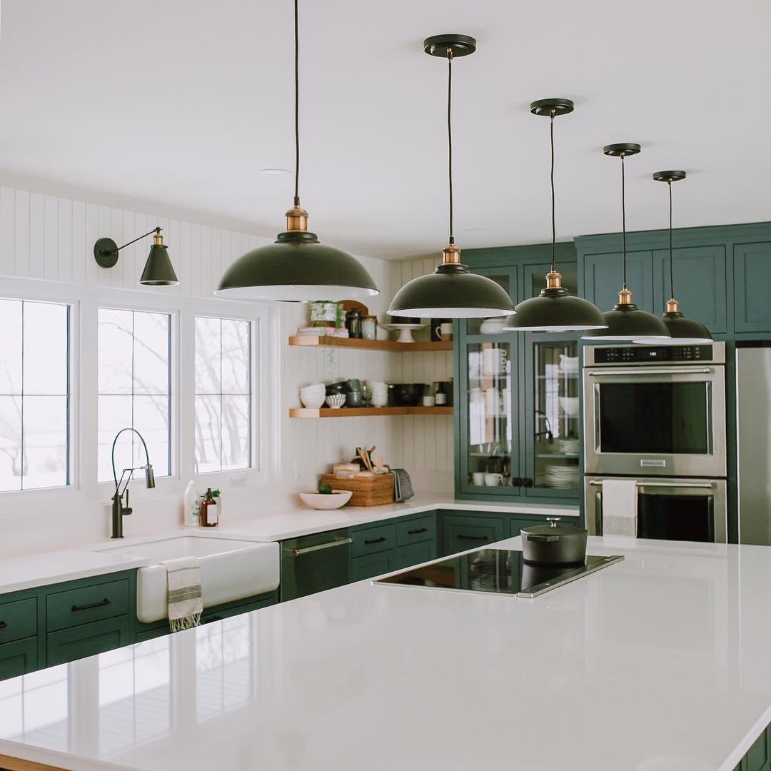 best green kitchen with oversized quartz island
