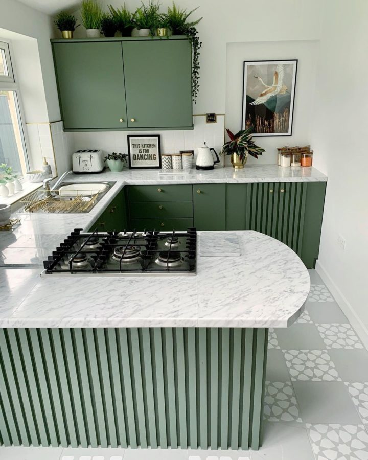 small modern green kitchen with white marble countertop
