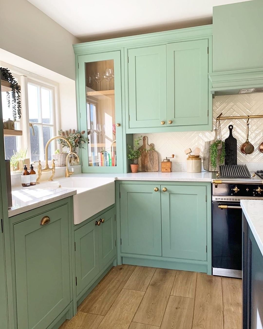 mint green kitchen with gold hardware