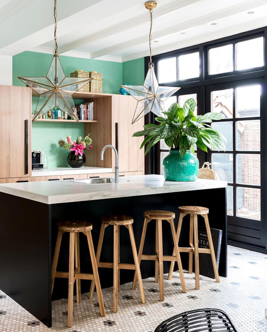 contemporary wood kitchen with black island and green wall