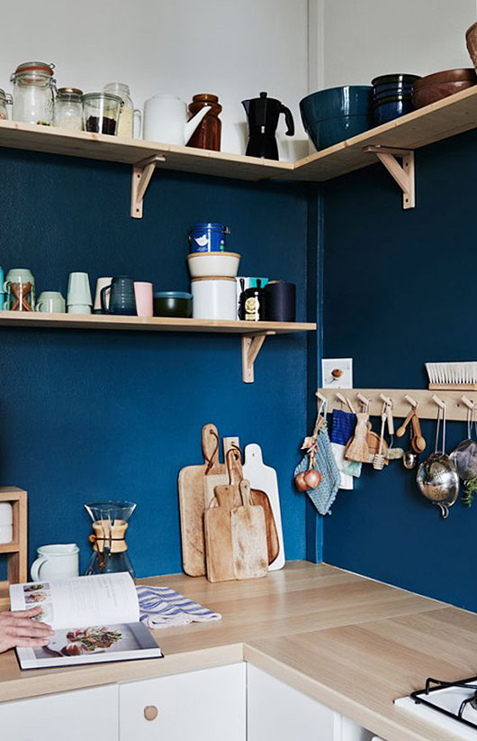 blue wall and open shelves