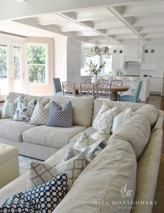 beige sofa with some beautiful pillows on it