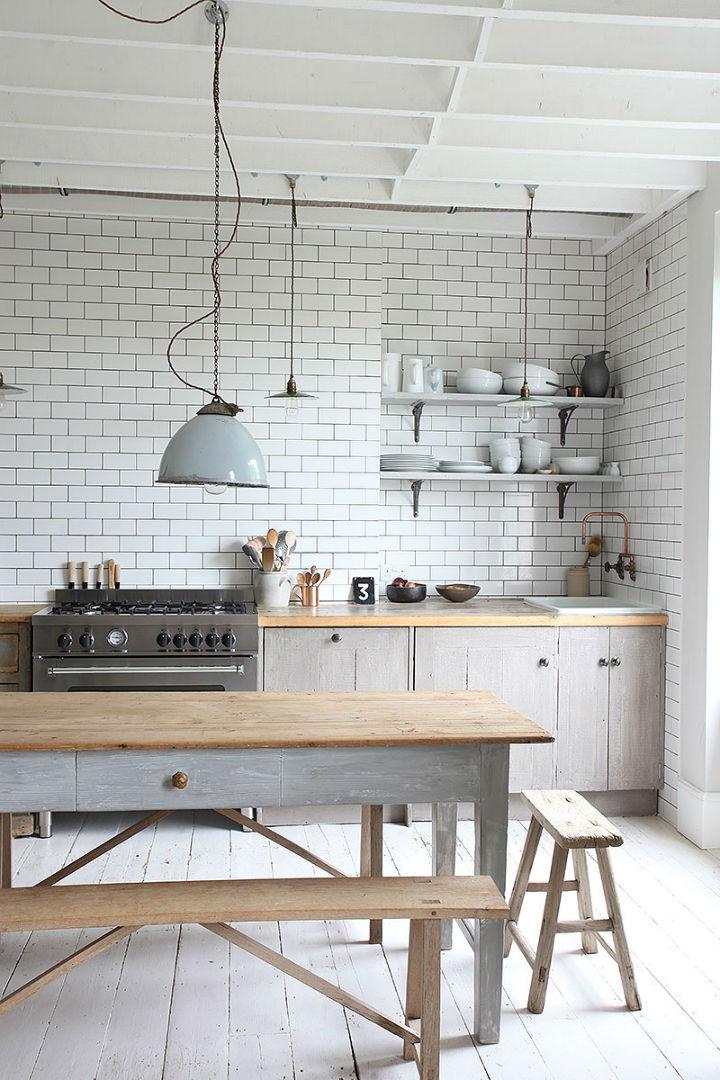 white kitchen tiles and round bulbs
