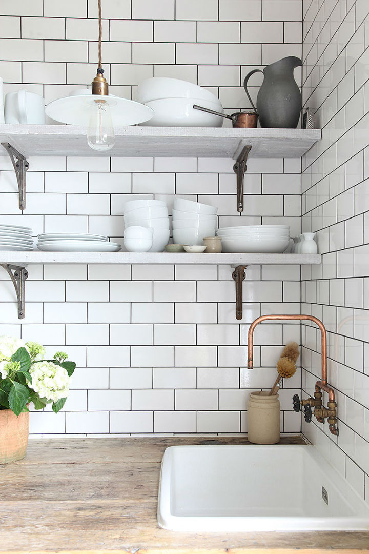 open shelves and white sink in kitchen