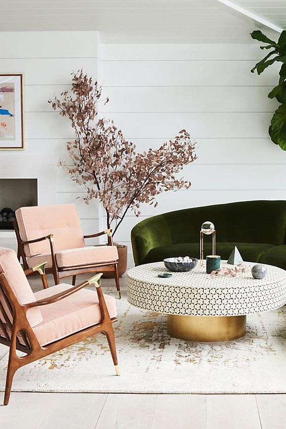 modern blush pink and green living room with velvet sofa